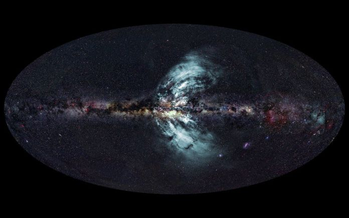 Two huge eruptions of material are streaming out of the Milky Way, seen in gamma rays by the Fermi space telescope. Credit:Ettore Carretti, CSIRO (radio image); S-PASS survey team (radio data); Axel Mellinger, Central Michigan University (optical image);