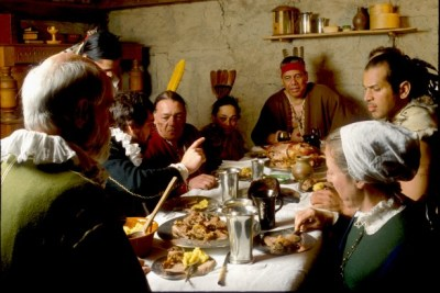"While many paintings of ""the First Thanksgiving"" show a single long table with several Pilgrims and a few Native people, there were actually twice as many Wampanoag people as colonists. It is unlikely that everyone could have been accommodated at one table. Rather, Wampanoag leaders like Massasoit and his advisors were most likely entertained in the home of Plymouth Colony's governor, William Bradford."