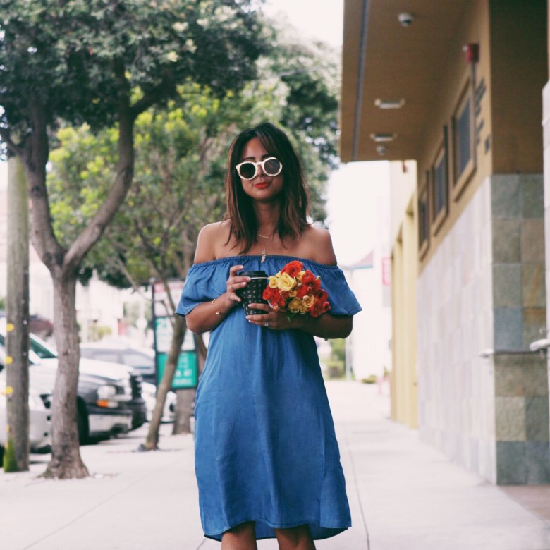 Off The Shoulder Spring Dress featured by top US fashion blogger Sylvie in the Sky; Image of a woman wearing off the shoulder dress and sandals.