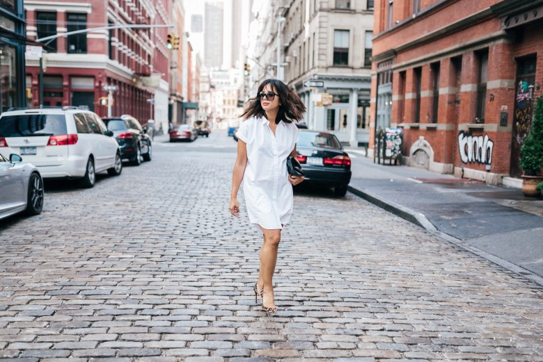 SHOP: 72 WHITE SHIRT DRESSES FOR WORK & MORE | Dresses for before and after Labor Day featured by popular San Francisco style blogger Sylvie In The Sky | SHOP: 72 WHITE SHIRT DRESSES FOR WORK & MORE by popular San Francisco fashion blog, Sylvie in the Sky: image of a woman wearing a white shirt dress, leopard print heels and walking across a cobblestone street in downtown San Francisco.