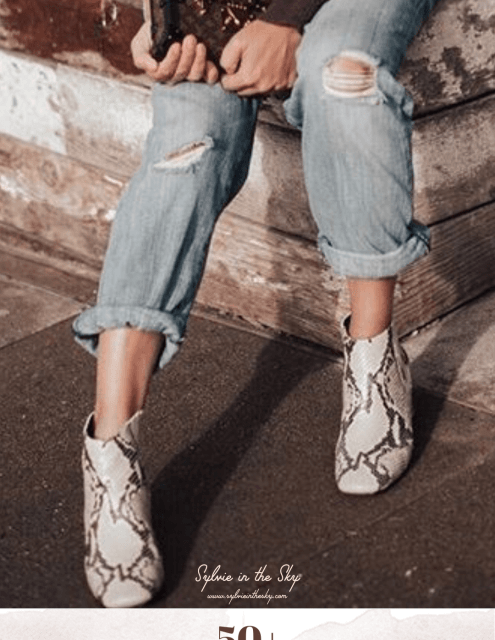 Best Snakeskin Boots for Women featured by top US fashion blogger Sylvie in the Sky; Image of woman wearing snakeskin boots.