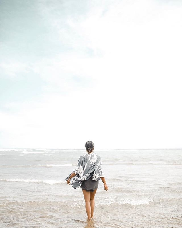 Positive Habits featured by top US life and style blogger Sylvie in the Sky; Image of a woman walking on the beach.