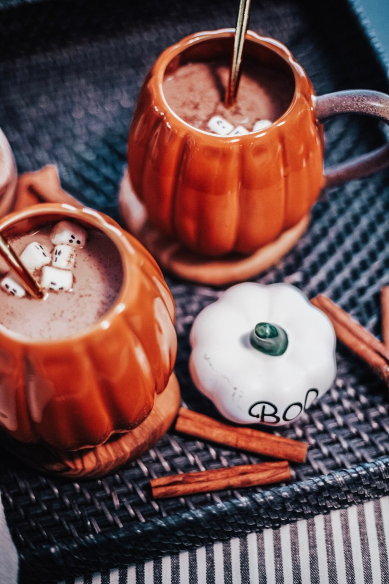 Halloween Hot Chocolate aka Pumpkin Spice Moon Milk Recipe featured by top US lifestyle blogger, Sylvie in the Sky: image of two ceramic pumpkin mugs with hot chocolate and mini ghost marshmallows in them.