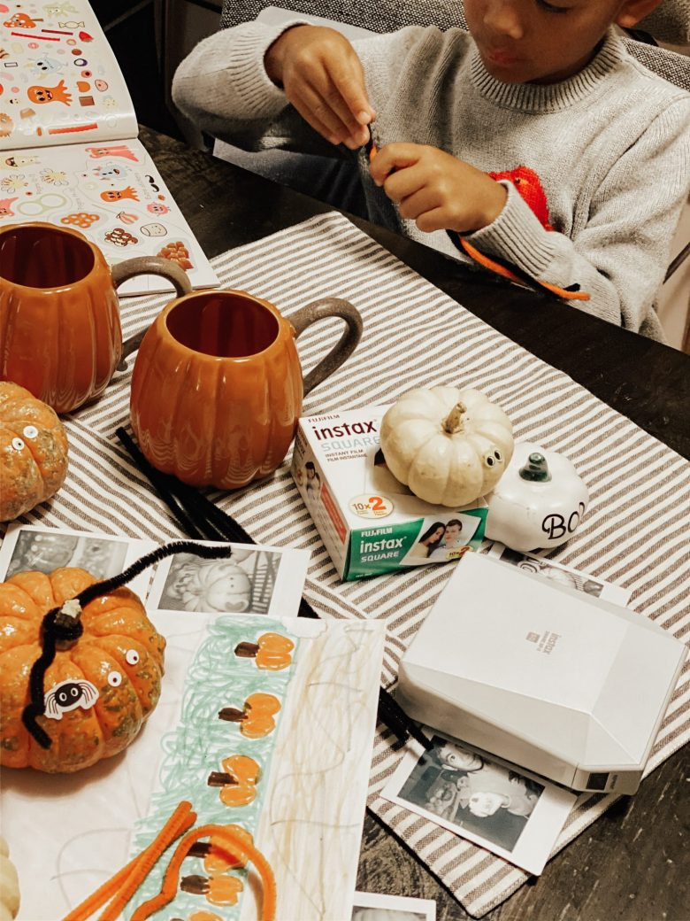 Easy Pumpkin Decorating Ideas for Toddlers & Kids by popular San Francisco lifestyle blog, Sylvie in the Sky: image of a kid decorating a mini pumpkin.