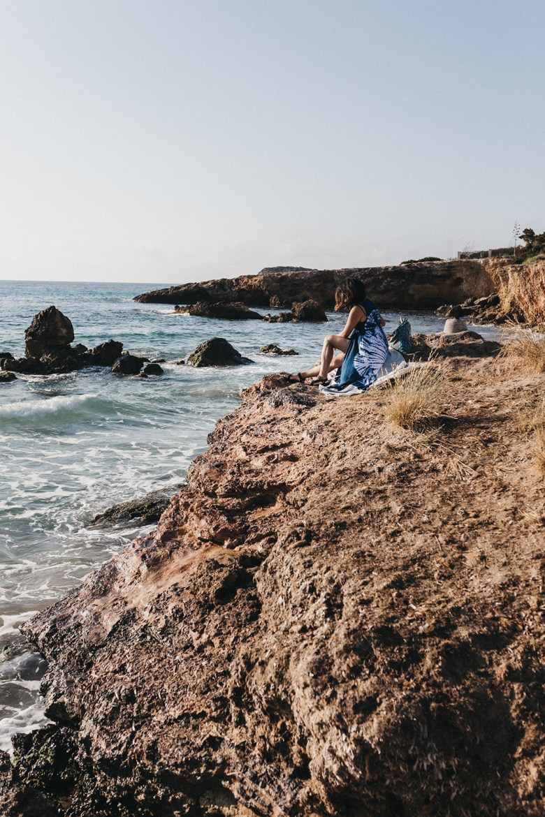 How to Manifest Anything You Want - 4 Steps by popular San Francisco lifestyle blog, Sylvie in the Sky: image of a woman sitting in the sand at the beach.