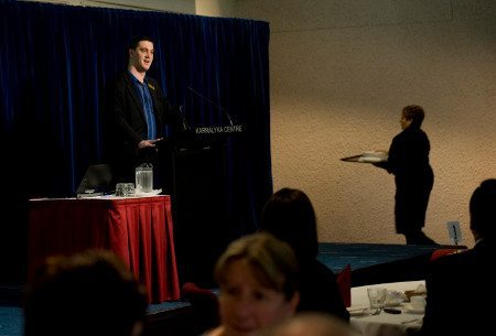 Alex serving as Master of Ceremonies and welcoming guests to the Eastern Volunteers Business Booster Breakfast