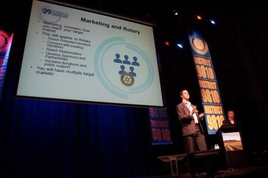 Alex and the presentation slides at the Rotary District 9810 Conference