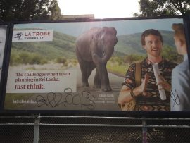 An ad for La Trobe University at South Yarra Station
