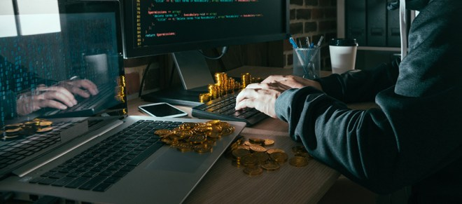 A hacker stealing cryptocurrency through malicious code insertion
