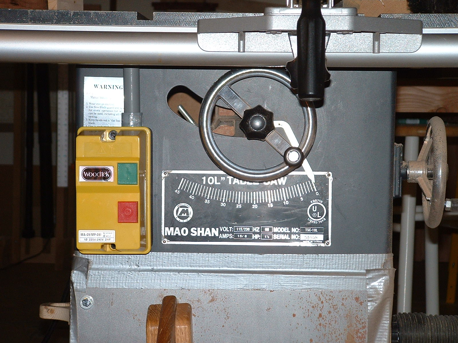 hight resolution of  table saw motor starter in the shop