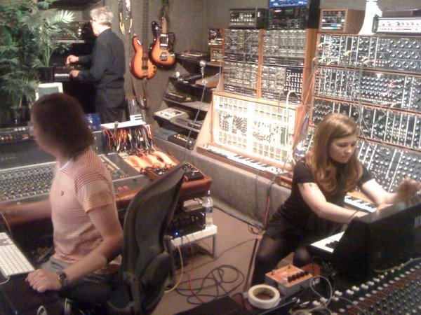 Composers Tara Busch & Benge Edwards working together in the studio with John Foxx.