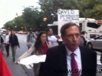 General David Petraeus reviled as War Criminal