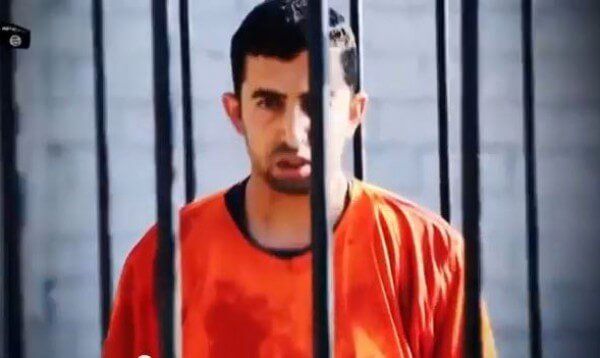 Jordanian Pilot Moath Kassasbeh in the Cage Awaiting to be Burnt Alive
