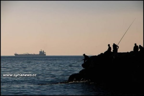 image-Tartus, fishermen enjoying the last sunbeams of the day