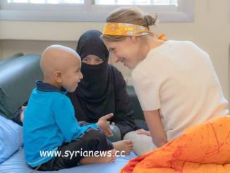 Syria's First Lady Asma Al-Assadvisits pediatric cancer center on the first day of Eid l-Adha.