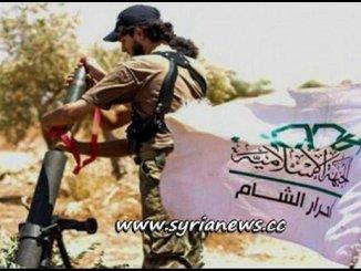 A Wahhabi terrorist from Ahrar Cham terrorist group in Idlib firing a mortar against towns in Hama countryside