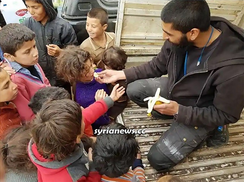 British terrorist Tauqir Sharif making Syrian children beg for a bit of a banana in Idlib