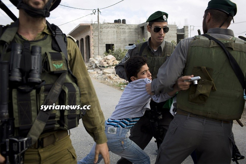 Israel IDF armed soldiers kidnap Palestinian child