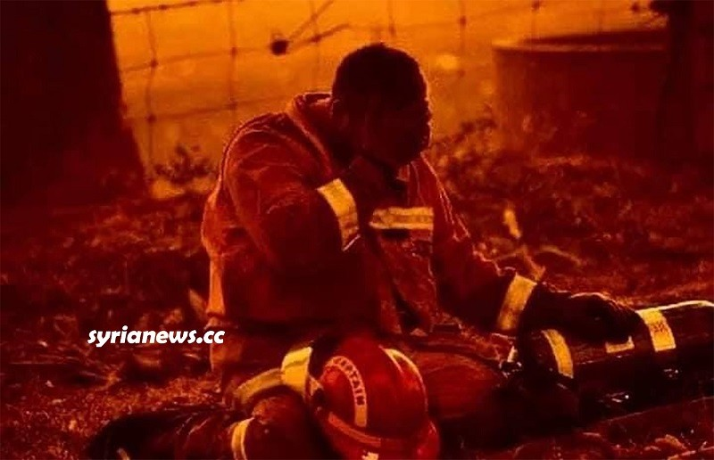 Syrian firefighter exhausted