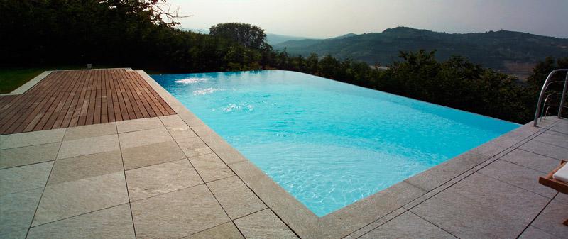 Costruzione piscine a Sfioro Skimmer sfioro cascata Bio
