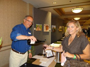 Michael Meluskey pours Qupé 2011 Syrah for Ana D'Arace at the 7th Annual Vino de Sueños Wine Release Celebration.