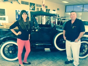 "Erica Valdés, People Helping People's (PHP) Associate Development Director, (left) and Dan Vreeland, Vreeland Ford Partner, pose with the Model ""A"" Ford truck that they hope people will fill with food during the Fill The Truck Food Drive.  Food collected will go to PHP to help feed those in need during the holidays."