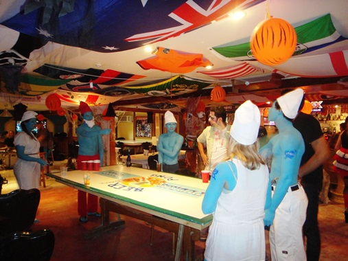 smurfs playing beer pong at pedros hotel