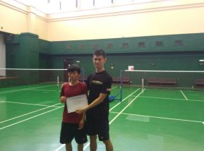 Coach Darma presenting the certificate of completiong