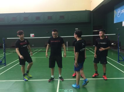 Coach Andrew briefing some exercises to the players