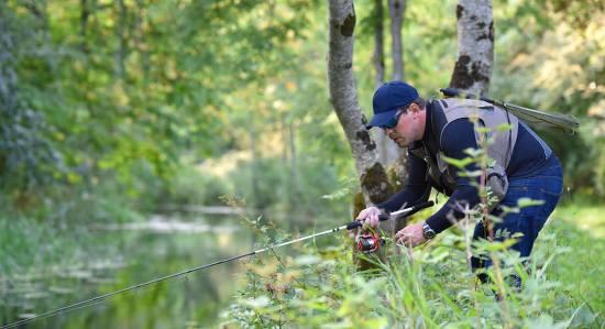 man fishing from Riverbank