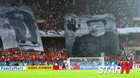 Korean fans hang a banner in honor of Ahn Jung-Geun