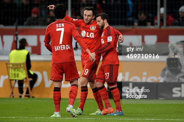 Son (left), Josip Drmić (center) and Gonzalo Castro celebrate after Drmic scored the third goal of Leverkusen's match against F.C. Köln.