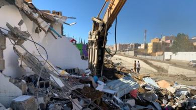 Photo of أمانة عسير تواصل أعمال المرحلة الرابعة في ازالة المباني المتداخلة بوادي المنسك