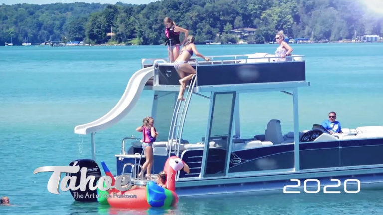 Kids playing on a double decker pontoon boat.