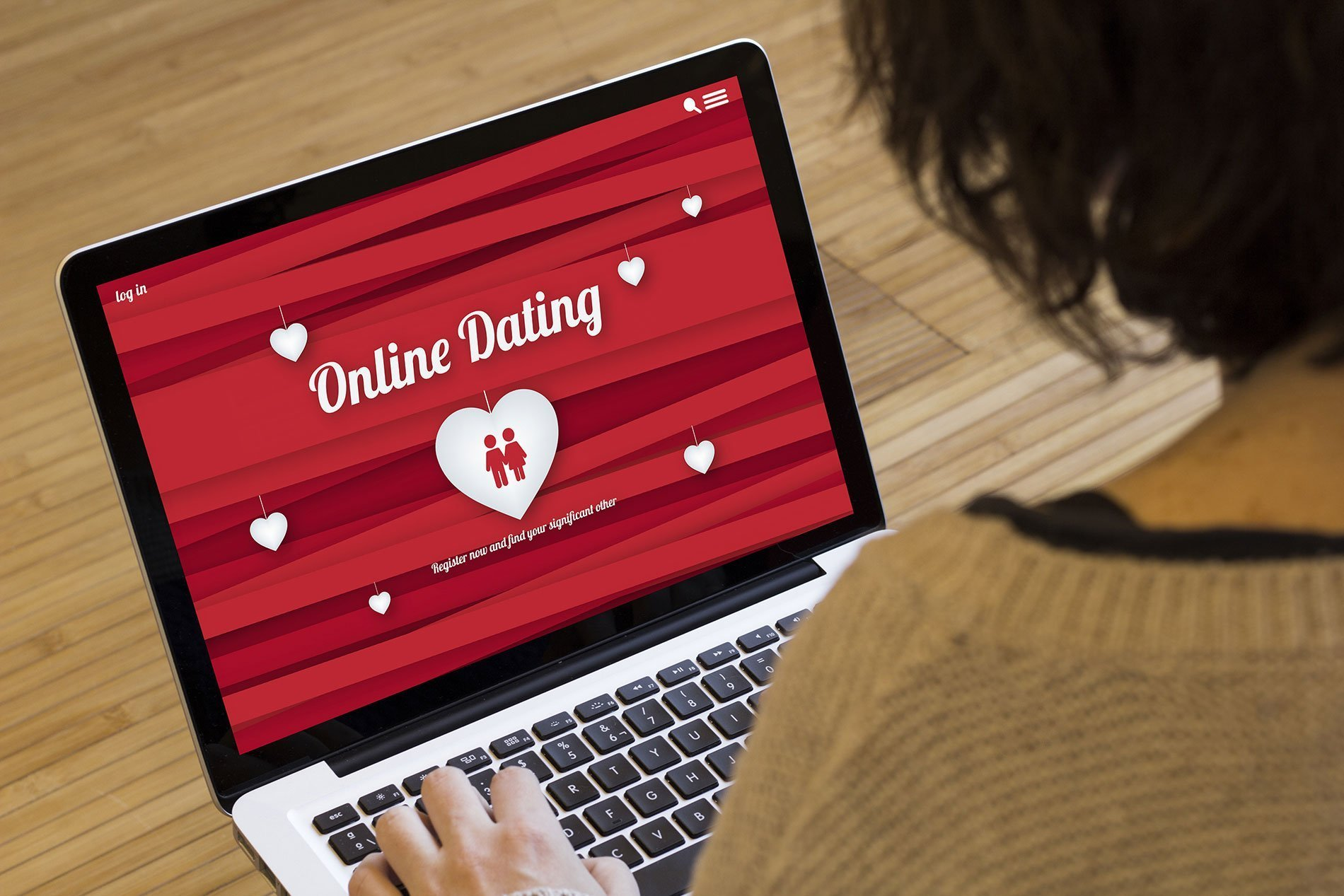 laptop with online dating site up in browser