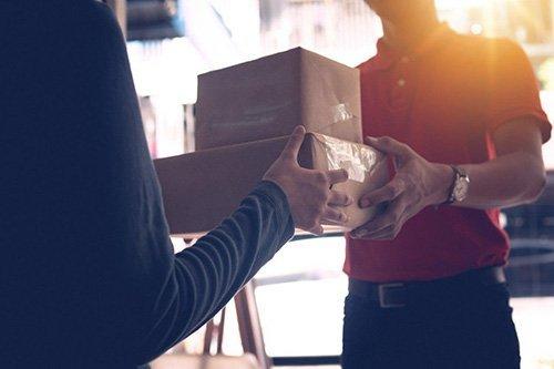 Woman receiving her parcels