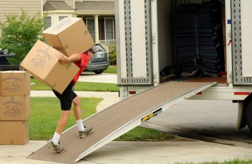 Man moving boxes into a loading truck