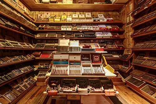 Picture of a large cigar selection inside a tobacco shop