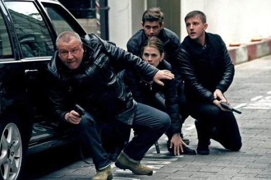 "Ray Winstone leading members of ""The Sweeney"" as they chase bad guys"