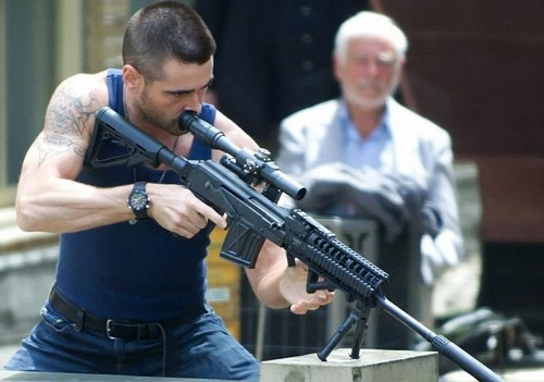 "Colin Farrell as ""Viktor"" in 'Dead Man Down' checking out a new weapon"