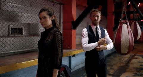 """Julian"" (Ryan Gosling) and ""Mai"" (Ratha Phongam) in Julian's boxing club in a scene from 'Only God Forgives'"