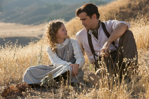 Annie Buckley as the young P. L. Travers (Ginty) and Colin Farrell as her father, Travers Goff in 'Saving Mr. Banks'