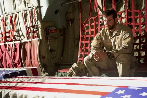 Bradley Cooper as CPO Kyle flying home with coffins of comrades in 'American Sniper'