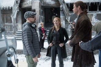 """(L to R) Director CEDRIC NICOLAS-TROYAN, JESSICA CHASTAIN as warrior Sara and CHRIS HEMSWORTH as Eric the Huntsman on the set of """"The Huntsman: Winter's War,"""" the story that came before Snow White. Hemsworth and Oscar® winner Charlize Theron return to their roles from """"Snow White and the Huntsman,"""" joined by Emily Blunt and Chastain."""