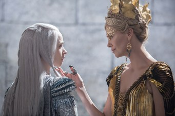 "(L to R) Queen Freya (EMILY BLUNT) is threatened by Queen Ravenna (Oscar® winner CHARLIZE THERON) in the story that came before Snow White: ""The Huntsman: Winter's War."" Chris Hemsworth and Theron return to their roles from ""Snow White and the Huntsman,"" joined by Blunt and Jessica Chastain."