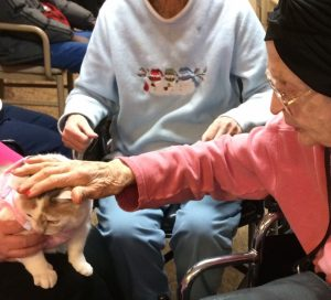 Miss Helen petting Kal-Ma at Medilodge Nursing Home