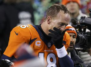 Denver Broncos quarterback Peyton Manning leaves the field after being defeated by the Seattle Seahawks in the NFL Super Bowl XLVIII football game in East Rutherford