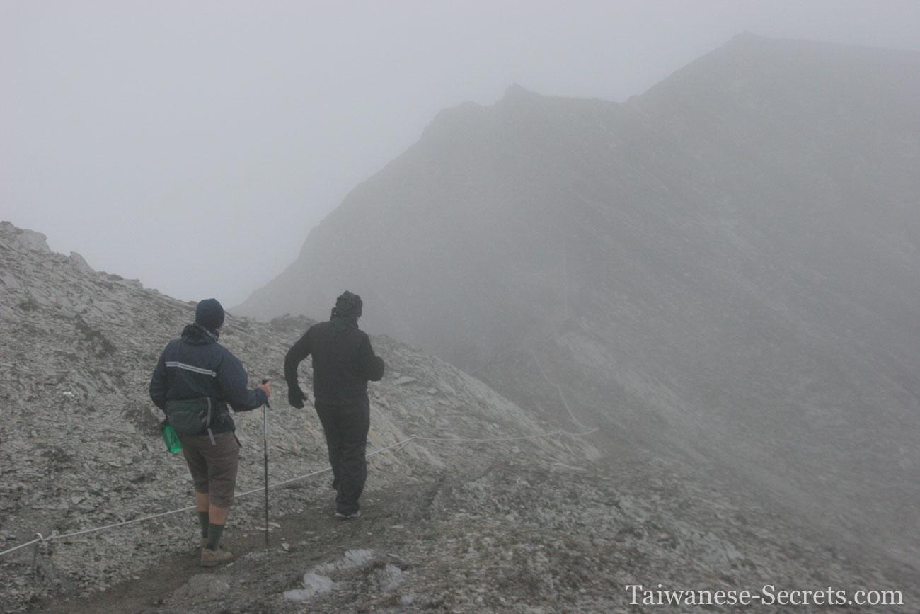 qilai mountain ridge in the clouds