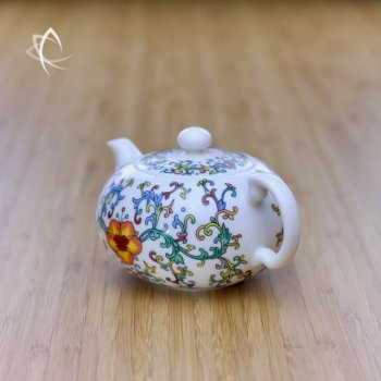 Elegant Teapot with Peony Motif Back Angled View
