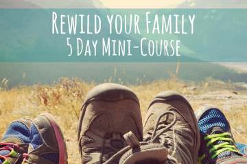 People's feet stretched out on the grass and in the distance a wide mountainscape. Text reads: rewild your family, 5 day mini-course
